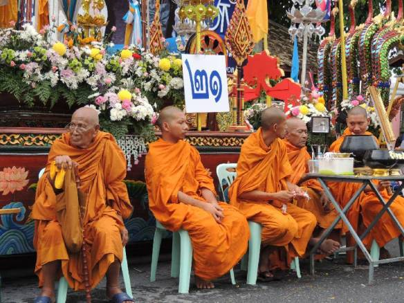 Monks with flowers